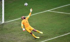 US goalkeeper Tim Howard makes a save during a Group G football match between USA and Portugal at the Amazonia Arena in Manaus during the 2014 FIFA World Cup on June 22, 2014.