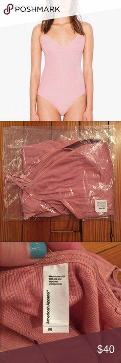 NWT American Apparel Sofia Bodysuit Paulette Pink Brand new comfy yet sexy 2x2 ribbed Sofia body suit from American Apparel. NWT bought from online, in packaging with hygiene liner still in place. Just tried on once (with undies) and realized I needed a small (if anyone wants to trade!). Light rose pink color, super soft. Please feel free to ask any questions and make an offer! I'd love to pass on this trendy piece to another AA lover :) American Apparel Swim One Pieces