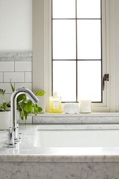 Sleek touches, like the tub filler, give this period-style bathroom an updated look.