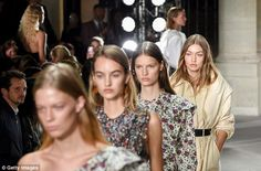 If you lead, I will follow: Gigi followed the glamorous pack of models on the runway...