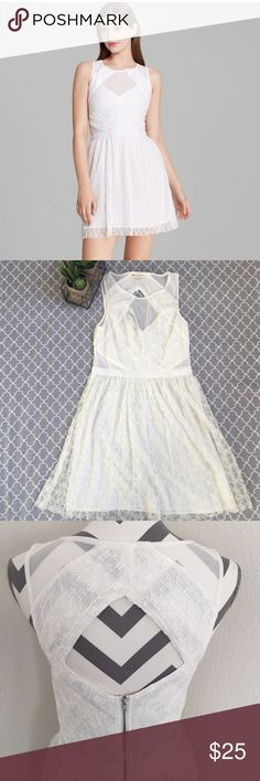 "Guess White Crinkle Lace Dress Cute and flirty dress, size 8, has mesh cutouts at the sides, diamond cut out in the back with silver zipper, approx measurements are: waist 29"", bust 30"", length from shoulder to hem 35"". EUC. Guess Dresses"