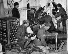 Maginot Line, French defensive installationTroops working in one of the underground artillery towers. Man in foreground is using a time-fuse setter Early 1940.
