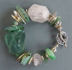 Love the rough flourite and the flow created from the combination of stones/silver.