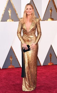 Margot Robbie is a bonafide bombshell in golden Tom Ford. Click to see more best dressed looks, presented by @dietcokeus.