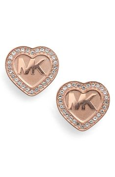 Sweet, sentimental and perfect for wearing every day, these glinting heart-shaped studs are stamped with a logo and traced with crystals. Style Name: Michael Kors Heart Stud Earrings. Style Number: 5427969. Available in stores.
