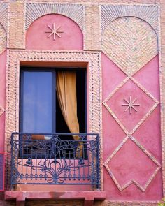 Marrakesh Balcony - A colourful and decrotive window and wall of a house in Marrakesh Morocco.