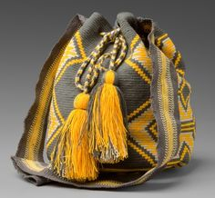 mochila satchels were made by the women of the wayuu tribe in colombia and venezuela Tapestry Bag, Tapestry Crochet, Knit Crochet, Crochet Bags, Mochila Crochet, Cross Stitch Geometric, Cultural Crafts, Grey And Beige, Handmade Bags