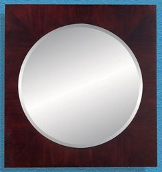 Add a geometric accent piece to your contemporary decor with the Cordovan mirror made from cordovan wood with a deep red luster. || Cordovan Mirror furniture.cort.com