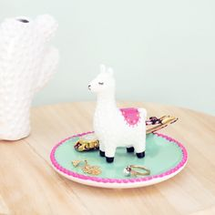 Llama shaped ceramic jewelry display by Sass & Belle. Made from ceramic, it features a cute llama resting on the center of a mint and rose dish. Alpacas, Cute Llama, Llama Llama, Llama Decor, Llama Gifts, Llama Birthday, Sass & Belle, Biscuit, Idee Diy