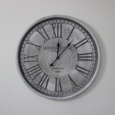 large grey round wall mounted clock vintage style home accessory feature