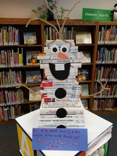 This Olaf could be done with white paper over books if not enough white covered books int the library.