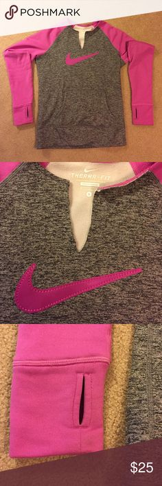 NIKE swoosh logo fleece lined therma fit Pullover Small Nike fleece lined therma-fit Pullover with pink stitched logo. Collar has been cut for easier on/off. Otherwise in great condition Nike Tops Sweatshirts & Hoodies