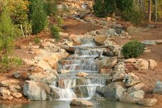 Waterfall commissioned by Richard Petty for Victory Junction Gang Camp in North Carolina. Landscaping Around Deck, Landscaping On A Hill, Landscaping Jobs, Backyard Water Feature, Ponds Backyard, Backyard Waterfalls, Garden Ponds, Koi Ponds, Outdoor Water Features