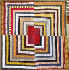 Housetop, 55 1/2 x 55 1/2, by Deb Rowden.  (Waste not, want not: Quilts from reclaimed clothing)