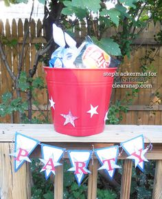 Steph shares how to make a DIY party bucket complete with banner, pinwheels, and other cool party stuff. Click on the photo for the instructions.