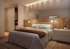 O aconchego da madeira para o quarto master. Linhas retas no mobiliário e espelho para ampliar o ambiente.