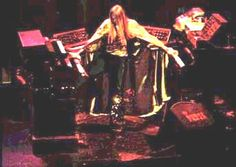 Rick Wakeman and his electronic friends: RMI electric piano & Harpsichord on top of Hammond C3, MiniMoog on top of Mellotron MkIV, another MiniMoog ontop of Mellotron MkIV, collection of mystery-modules+mixer on top of Baldwin Grand piano.