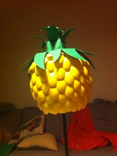 Dyi pineapple lamp with plastic spoons