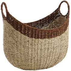 Behind its striking shape, fun handles and unique hand-woven texture is one very sensible basket. It magically manages tons of clutter, can easily be grasped and moved on a whim, and looks good at all times, in all kinds of settings. No matter how you task it, this basket gets it done.