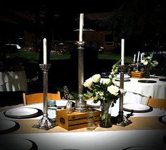 Vintage silver candle sticks provide elegance among burlap, blue ball jars and vintage bottles.