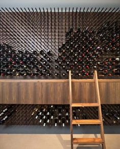10 eye-popping winery designs- 10 projetos de adegas de encher os olhos Similar to a pegboard with several brackets, the panel can accommodate numerous bottles of wine. The cupboard, which supports the stairs, complements the wine cellar. Wine Cellar Design, Wine Design, Wine Shelves, Wine Storage, Display Shelves, Storage Ideas, Cave A Vin Design, Bar Sala, Home Wine Cellars