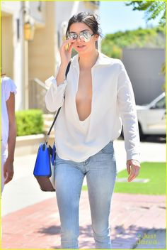 kendall jenner narrowly avoids nip slip in super low cut top 06