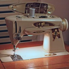 I just bought this Old Singer 503 Sewing Machine at a church rummage sale with a mid century modern sewing table and all the attachments!! Can't wait to start using it:)