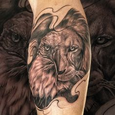 Black And grey realism lion and eagle tattoo