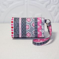This would make a great gift for someone on Valentine's Day...   Cell Phone Wallet Wristlet by Cucio on Etsy, $29.95