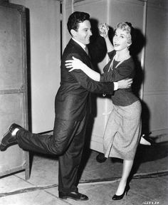 Full BTS shot of Cameron Mitchell as Johnny Alderman and Doris Day as Ruth Etting dancing.