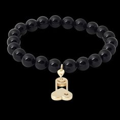GOLD CHARMS WITH BLACK BRANSLET
