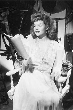 Rita Hayworth,  on movie set, drinking Royal Crown Cola