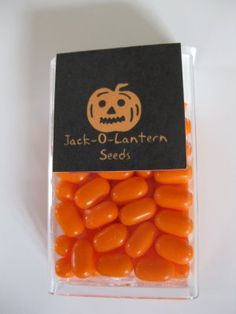 Jack-o-lantern seeds with orange tic-tacs!