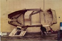 """If you look closely, you will see PVC pipes (cut length wise) glued behind each narrow line of the windows and doors. There are also wooden pieces glued into the roof and door sections to allow us to mount boat hardware for hinges and latches. Once the fiberglass was laid over all of these structures, the body had its own """"space frame"""". These are boat builder's tricks that we """"borrowed"""" from them."""