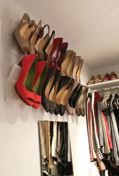 What a clever idea!  Elegant shoe racks made out of angled moulding.  Love it!