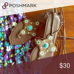 Brown Lace Up Sandal Impo by Anthro sandals in brown with turquoise accents, barely worn but purchased years ago. Super comfortable and you can adjust how you lace them up! Anthropologie Shoes Sandals
