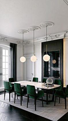 Smaragd gepolsterte Stühle auf schwarzem Rahmen sehen schick aus und fügen Farbe zum Bereich hinzu