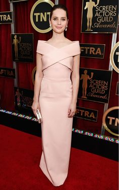 Felicity Jones in a blush Balenciaga dress and Van Cleef & Arpels jewelry at the 2015 SAG Awards