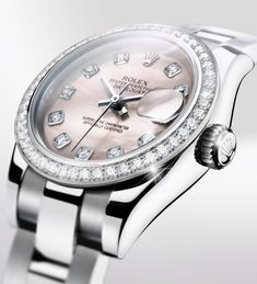 The Lady-Datejust 26 in white Rolesor, with diamond-set bezel and appliques and a pink mother-of-pearl dial.