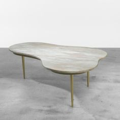 T.H. Robsjohn-Gibbings, Marble and Brass Coffee Table for Lane Furniture, 1951.