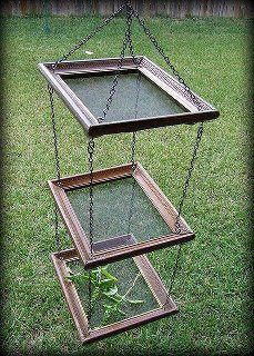 herb drier made from old picture frames and a bit of mesh , you could use cord instead of the chains