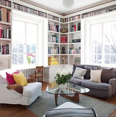 Fill all the walls with books so that you create nooks and desk spots. Perfect for a large room to make it a little cozier!