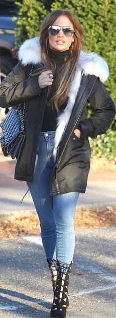 Who made Jennifer Lopez's black quilted handbag, cut out boots, and coat?