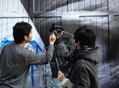 French street artist JR and camouflage artist Liu Bolin in Nolita