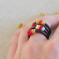 http://www.etsy.com/listing/47310970/leather-and-cotton-ring