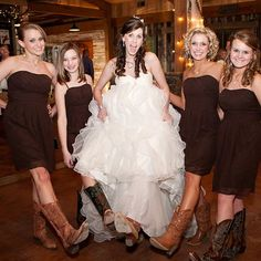Real Weddings - In Bliss Weddings: The bride and her bridesmaids pose for a picture all wearing their cowgirl boots! A southern girl can't be without her boots! Photo Credit: John Mathis Photography