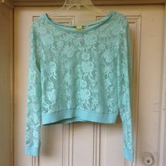 Floral Lace Top by The Girl That Loves This is a long sleeve floral lace (modestly cropped) top in a pretty teal shade. Can be worn casually with jeans or dressed up for a romantic night out. 100% polyester, gently worn. The Girl That Loves Tops