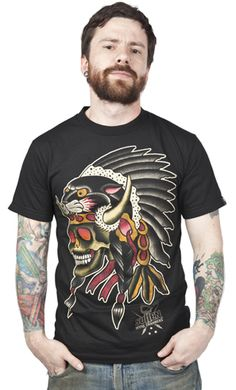 "The Tomahawk t-shirt from Sullen, designed by artist Myke Chambers, is a short sleeve black tee with a full color traditional tattoo inspired design of a skull Indian Chief with ""Sullen...Myke Chambers"" printed at the bottom. The back has crossed tomahawks & ""Sullen...Art Collective Myke Chambers"" printed around it.  $25.00"