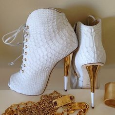 These shoes just stopped my heart!!! Guiseppe Zanotti crocodile embossed booties