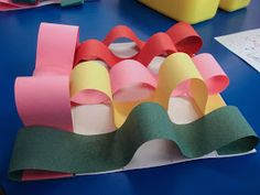 """Materials: - 2"""" Construction Paper Strips - Glue Sticks - Rulers - Pencils - 10"""" x 10"""" White Drawing Paper"""